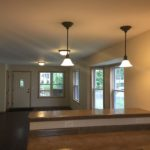 A view from an open kitchen to the living and dining room in a new construction home.
