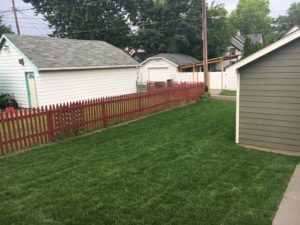 Fresh sod in the back yard of a new construction home.