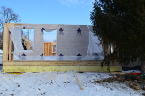 A property under construction. The foundation is complete and the walls for the first floor are in place.