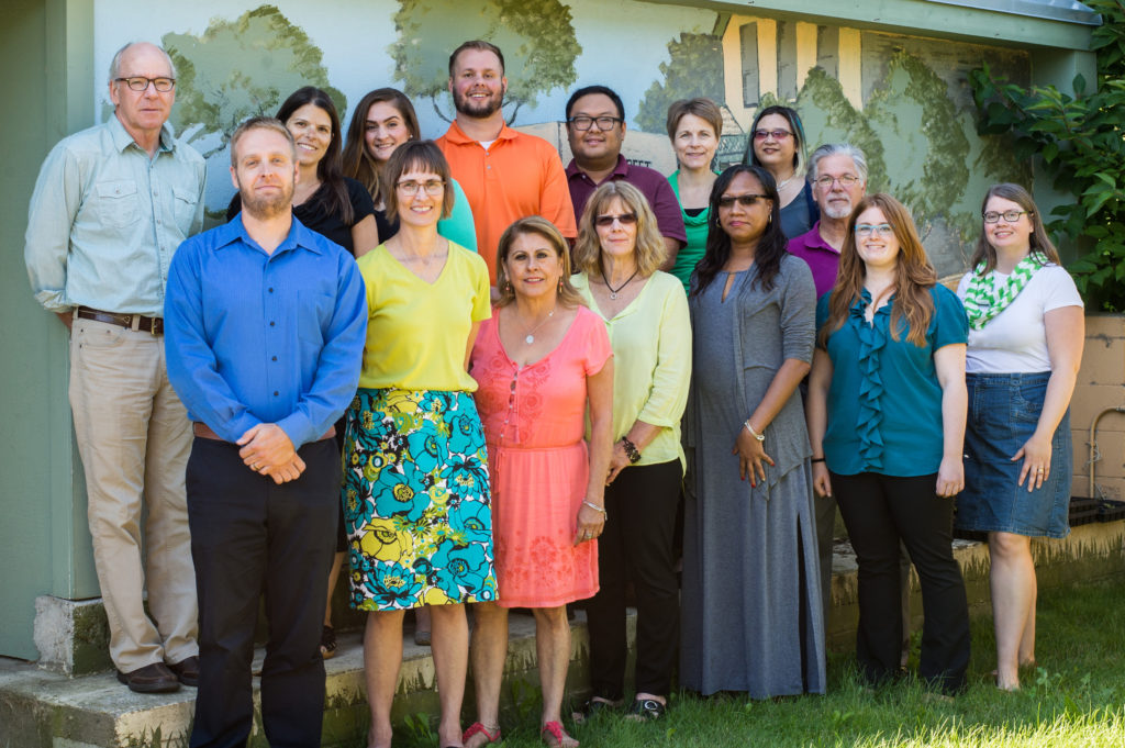 Staff of NeighborWorks Home Partners pose for a group photo in the garden.