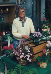 Greenhouse owner Barb Stromer with flowers