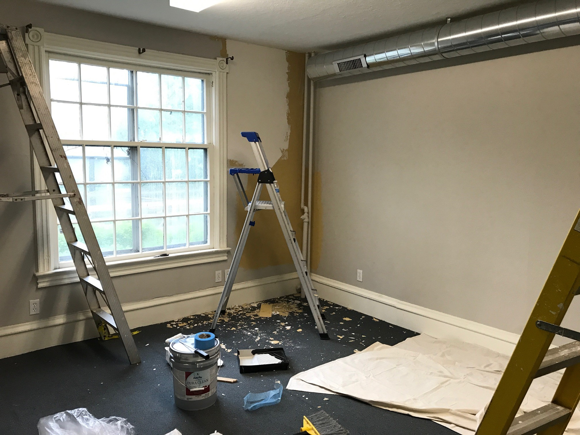 plaster repairs and fresh paint prepare this office area