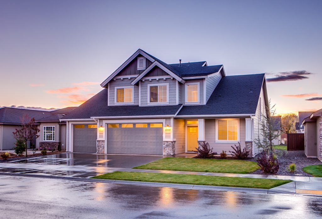 A two-story home pictured at dusk. MHFA's fix up fund can be used for a variety of home improvements.