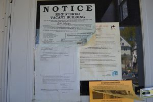 notices posted on the door of a vacant home
