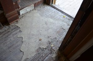 deteriorated flooring in the entry way