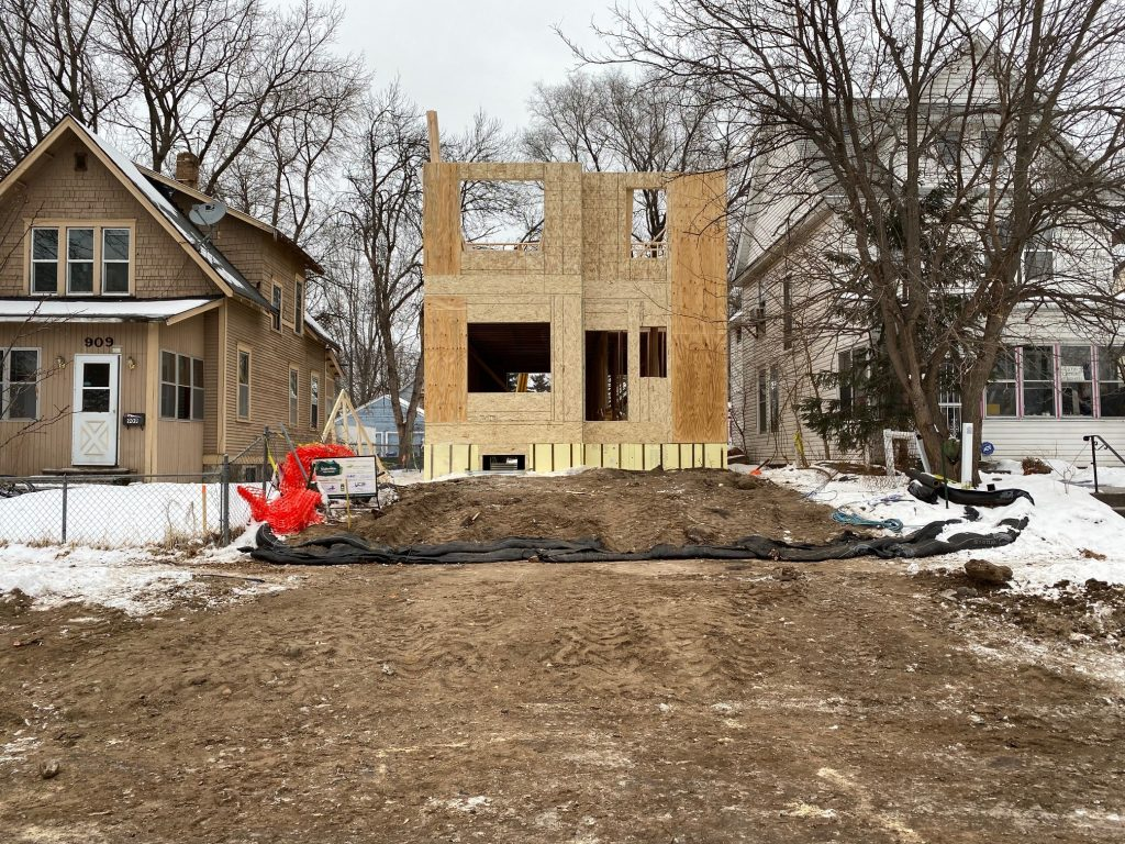 Home construction in progress during framing. The first story is complete and the second story is partially complete.