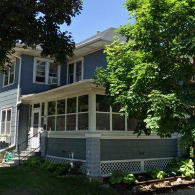 A two-story house with a low-pitched craftsman-style roof that was replaced through NeighborWorks' home improvement program.