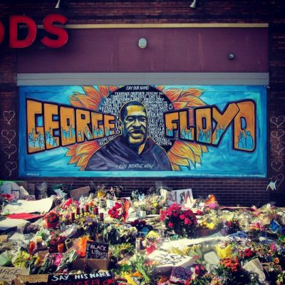 Flowers are massed at a memorial for George Floyd after his death at the hands of Minneapolis police.