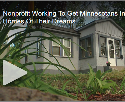 """A screenshot of the news story video. The image shows a customer's new home, and is captioned """"Nonprofit Working To Get Minnesotans Homes Of Their Dreams"""""""